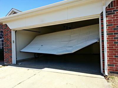 Damaged Garage Door Out Of Track