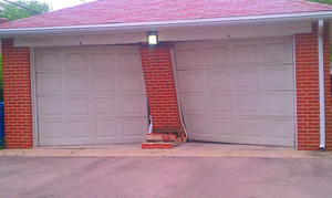 Garage door brick pillar car crash