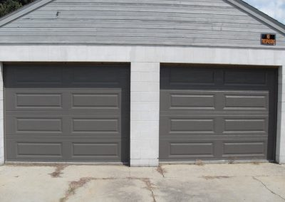 Grey Bronze Garage Doors Block Building