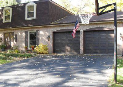 Two brown CHI short panel garage doors