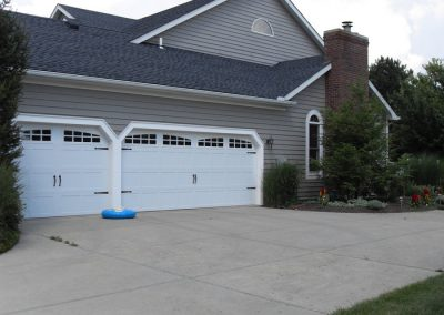 Three car CHI garage overhead door Carriage House